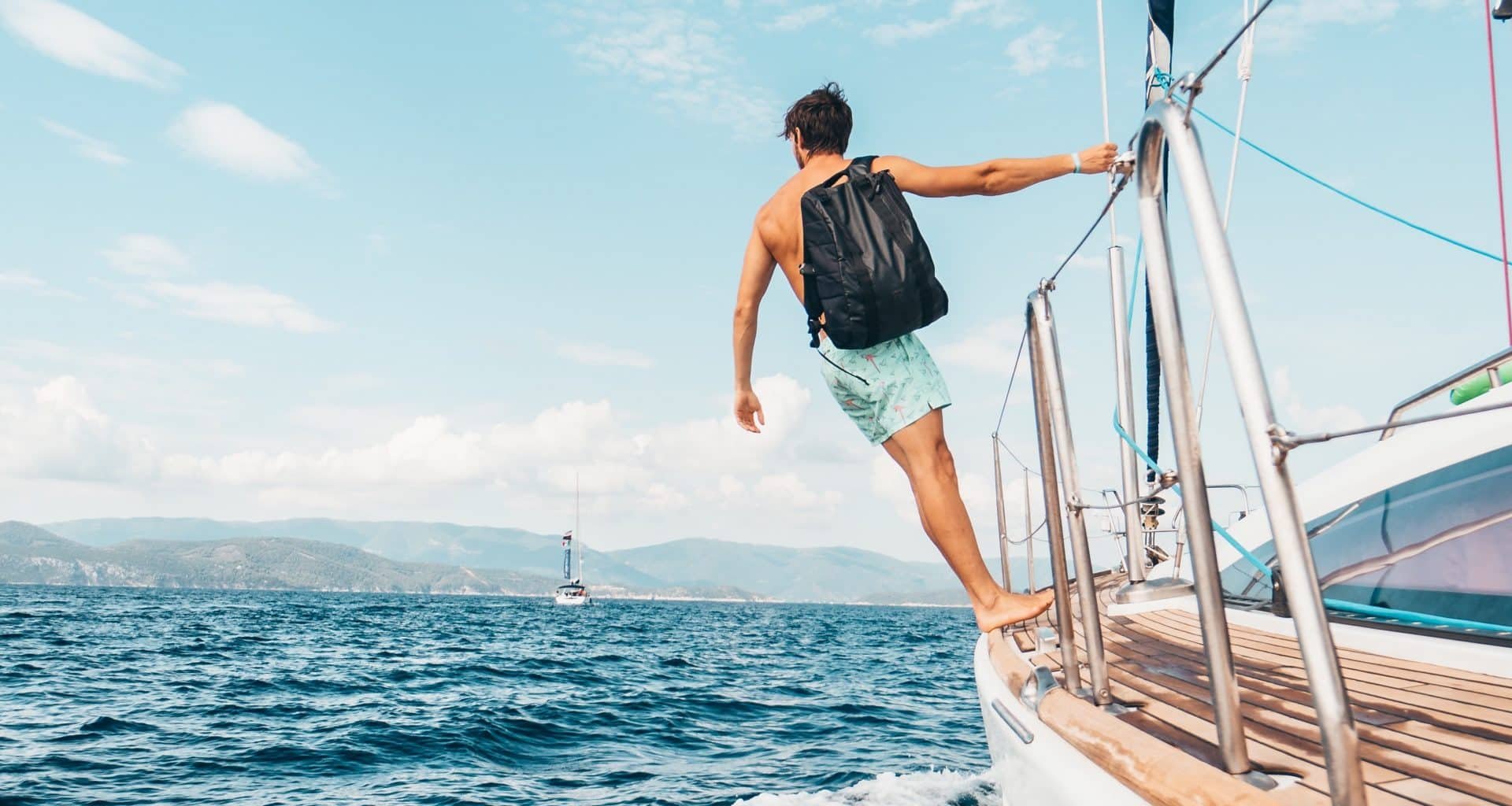 man wearing backpack standing on side of boat during daytime 1223648 1920x1024 1 - 5 Things Native English Speakers Never Say!
